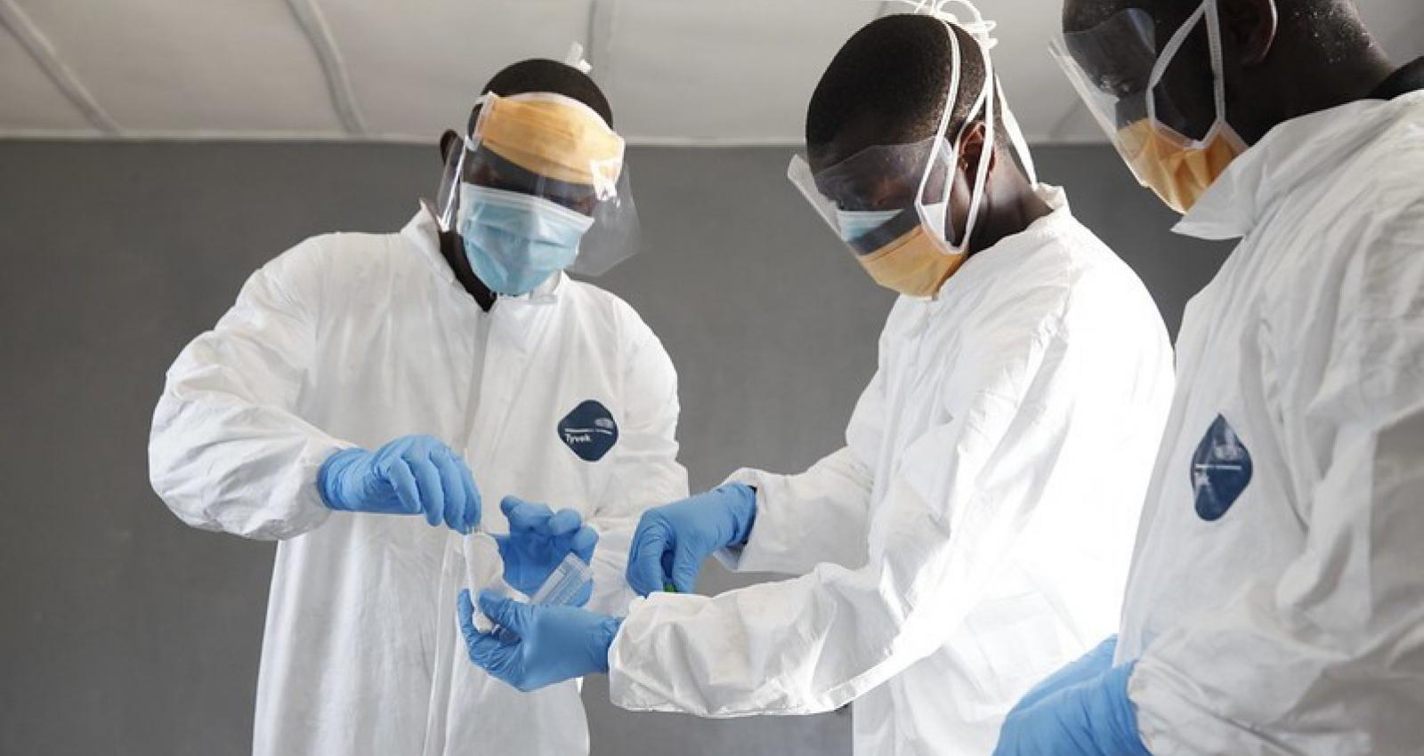 James Cooper, Sunday Bondo and Patrick Lappaya work together closely to take a sample swab to help determine the death of a women at C.H. Rennie Hospital in Kakata, Margibi County in Liberia on March 10, 2016. Image Credit World Bank