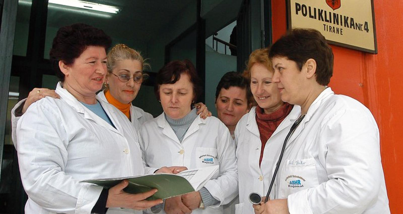 Doctors congregating outside a hospital in Tirana in 2004. Despite gains made in closing gender gaps in the past decade, the COVID-19 pandemic is exacerbating inequalities. Photo: Albes Fusha/The World Bank.