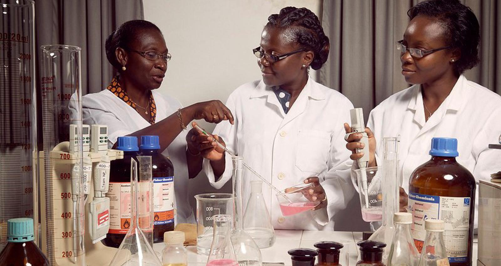 "Photo: © Stephan Gladieu / World Bank. Prof. Amivi Kafui Tete-Benissan (left) teaches cell biology and biochemistry at the University of Lomé. She's also a vocal activist who encourages girls to pursue science as a career path. ""Female students represent only 10 percent of our student body in science and engineering,"" she says sadly."