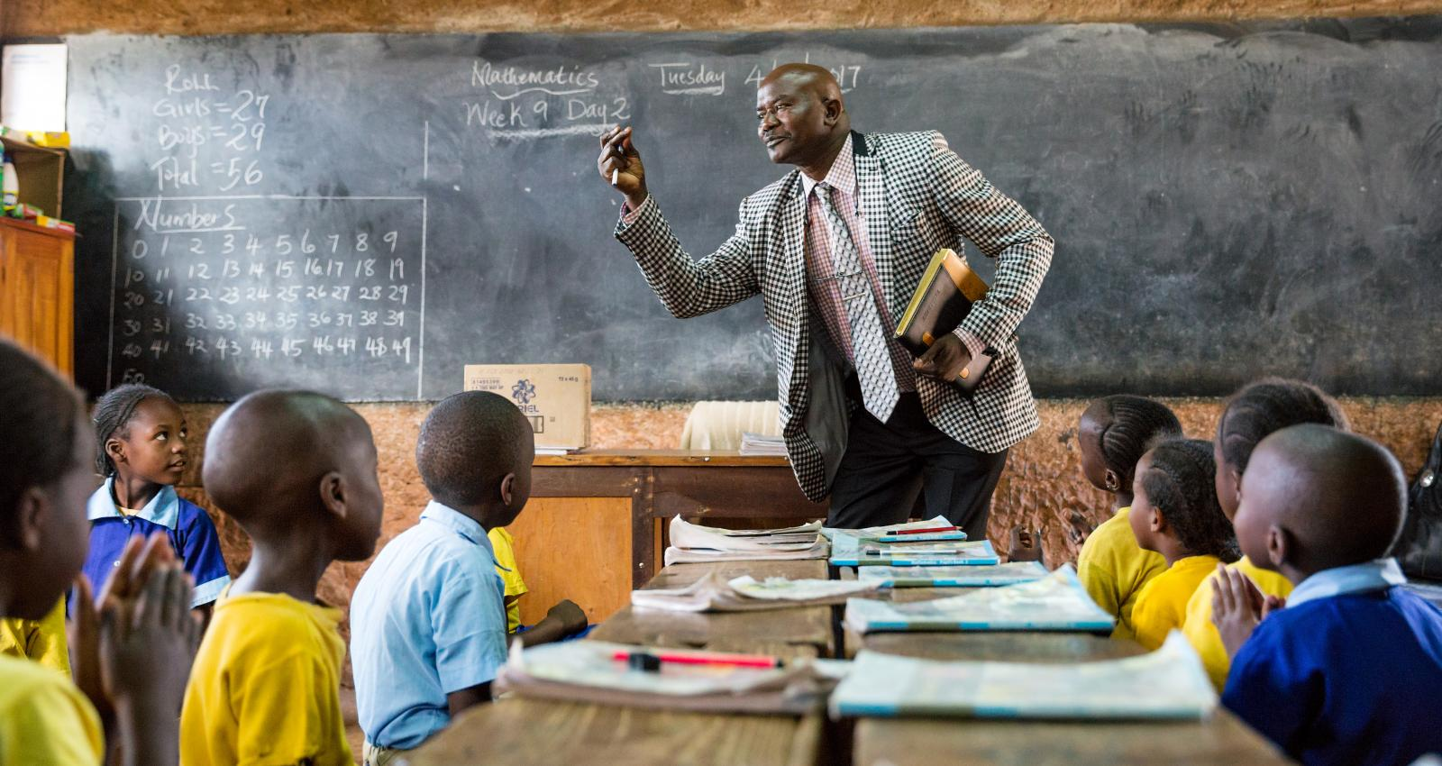 Pictured above: A teacher with his students in class Kenya, April 2017 Credit: GPE/Kelley Lynch