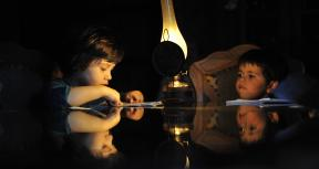 High peak demand for energy in FYR Macedonia can result in power outages around the country. Here a young child does homework by lamplight in a home outside of Skopje. Photo: Tomislav Georgiev / World Bank